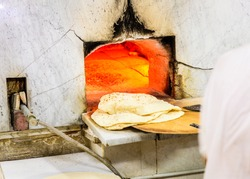 Baking traditional arabic flatbread at a bakery in Dubai's Old Town