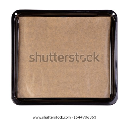 Baking tray with brown baking paper isolated on white background Foto d'archivio ©