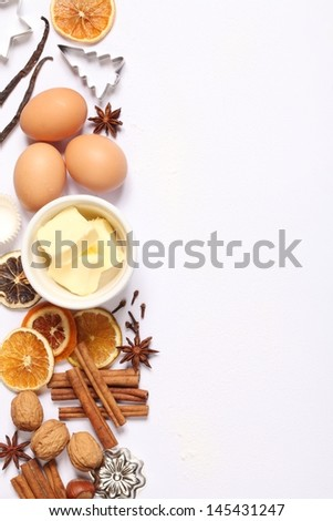 Baking utensils, spices and food ingredients on white background with copy space.