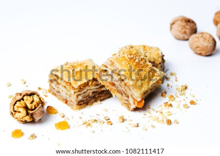 Baklava dessert slices with nuts on white background