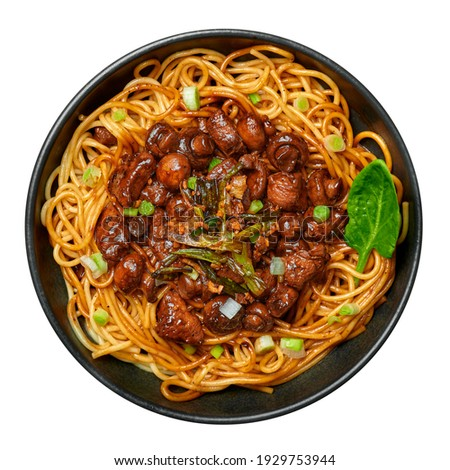 Bakmi or Mie Ayam in black bowl isolated on white. Indonesian cuisine noodles meat dish. Traditional asian food and meal. Top view Zdjęcia stock ©