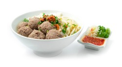 Bakso Meatballs and Noodles with Soup Served Chili Sauce Indonesia Food Style Popular Street Food Goodtasty decorate with carved Leek and Spring Onions sideview