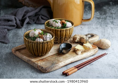 Bakso or baso is an Indonesian meatball soup, made а beef and chicken on the grey background                               Сток-фото ©