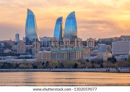 Baku, Azerbaijan, Flame Towers buildings dominating the city skyline on dramatical sunset