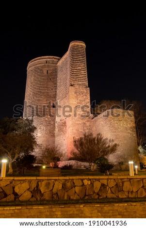 Baku - Maiden Tower at night time. Historic buildings of Baku: 12th century.