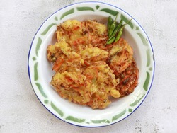 Bakwan sayur or bala-bala or ote-ote is vegetebles fritter from Indonesia. Usually served with bumbu kacang or sambal or small chili pepper. Selective focus.