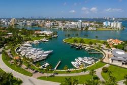 Bal Harbour marina with luxury yachts Miami Beach FL aerials