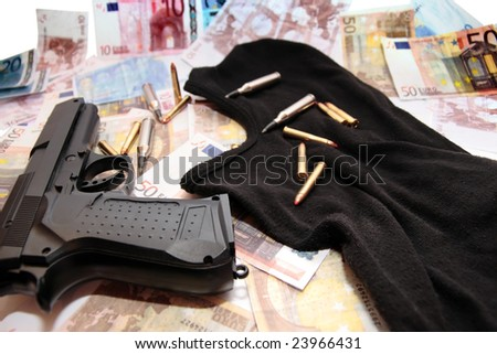 balaclava money gun and bullets showing a concept of a robbers or terrorists activity