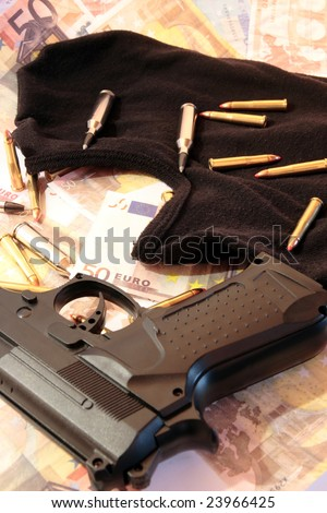 balaclava, money, gun and bullets showing concept of a robber or terrorist activity
