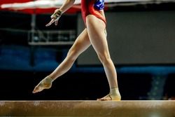 balance beam girl gymnast to competition in artistic gymnastics