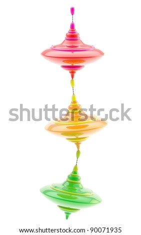 Balance conception: three kinds of colorful glossy whirligigs standing one on another isolated on white