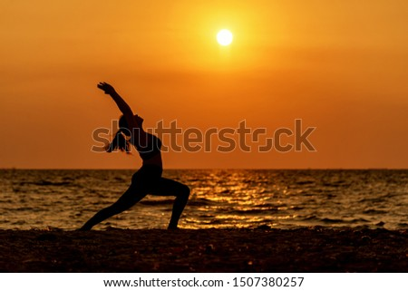 Balance meditation yoga spirit life mind woman peace vitality, silhouette outdoors on the Sea sunset, relax vital abstract. Healthy Life and Lifestyle Concept