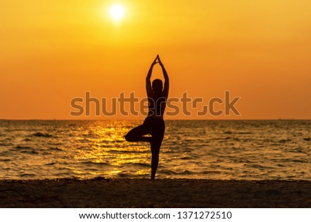 Balance meditation yoga spirit lifestyle mind woman peace vitality, silhouette outdoors on the Sea sunrise, relax vital abstract. Healthy and Lifestyle Concept