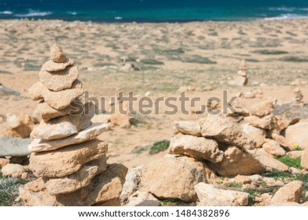 Balance of large stones on the beach, a mound. The concept of harmony, equilibrium, Zen