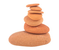Balance red stones are arranged in a pyramid shape isolated on a white background. Zen stones. Spa concept.