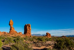 Balance rock in Arches National Park, vivid red rocks and rich blue sky in an afternoon.