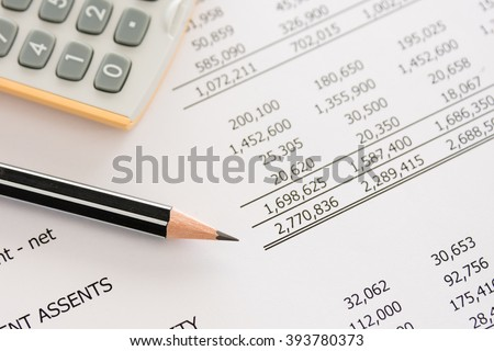 Balance sheet ,pencil, calculator on accountant's desk. Accounting , accounts concept. top view, above view.