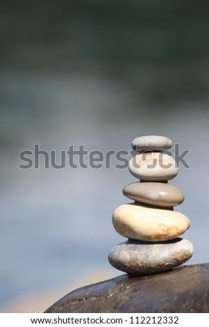 Balance stone on river coast