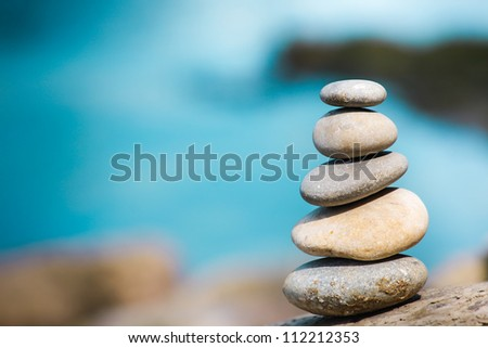 Balance stone on river coast