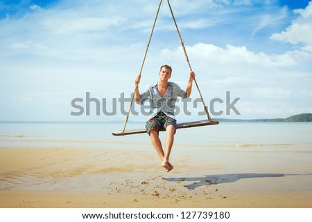 balance, thoughtful man on the swing #127739180
