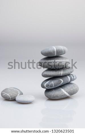 Balance zen pebble grey and white stones on white background