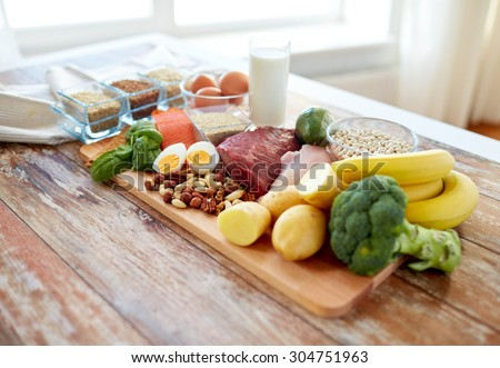 balanced diet, cooking, culinary and food concept - close up of vegetables, fruit and meat on wooden table #304751963