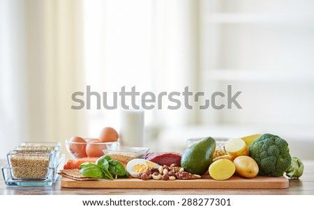 balanced diet, cooking, culinary and food concept - close up of vegetables, fruits and meat on wooden table #288277301