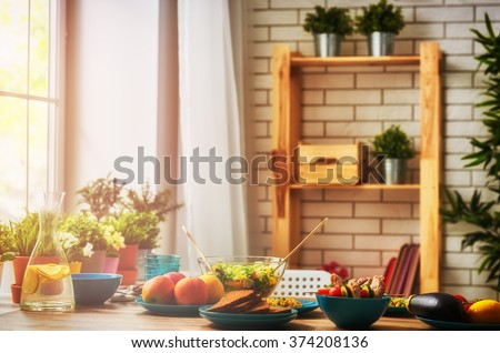 balanced diet, cooking, culinary and food concept. food for a family dinner on a wooden table in the dining room. #374208136