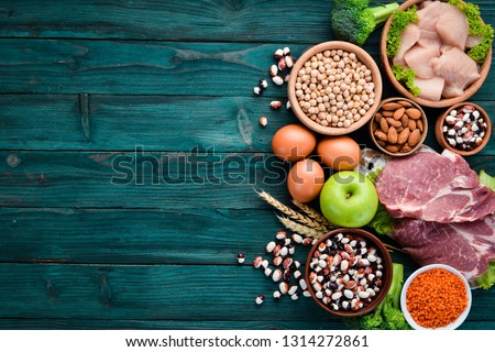 Balanced diet food background. Protein foods On a blue wooden background. Free space for your text.
