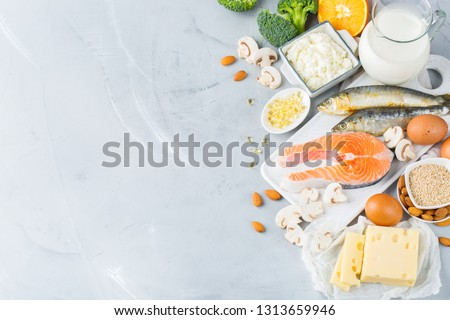 Balanced diet nutrition, healthy eating concept. Assortment of food sources rich in vitamin d and calcium, salmon, dairy products, sardines, broccoli on a kitchen table. Copy space background Zdjęcia stock ©