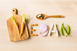 Balanced healthy vegan supplements concept. Top view variety of vegetables arranging to a word