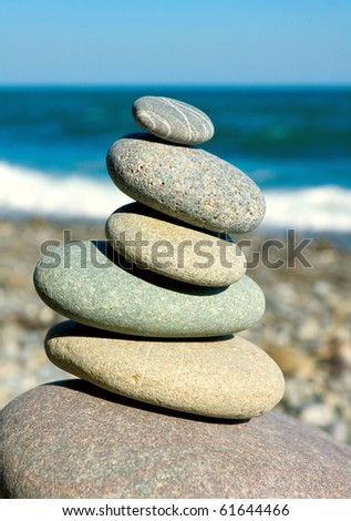 balanced pebbles on sea in nice summer day