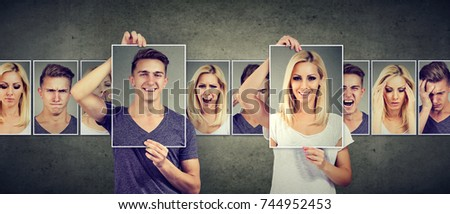 Balanced relationship concept. Masked woman and man expressing different emotions #744952453