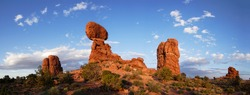 Balanced Rock - a boulder estimated at 3500 tons weight - sits perched on a precarious pedestal - Arches National Park, Utah state. Stitched panorama.