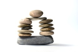 Balanced small stones on the floor with whie plain background. Zen and relax concept