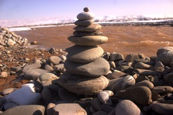 Balanced stones by the river