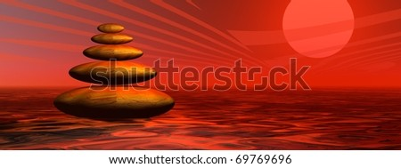 Balanced stones in the desert by colorful red sunset