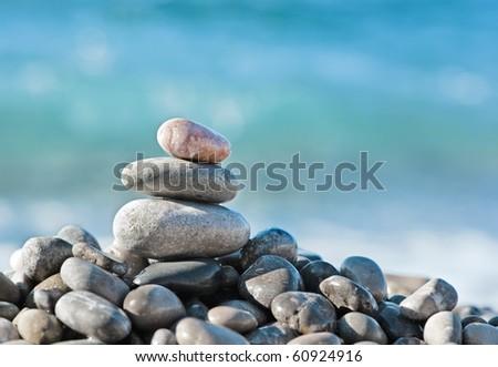 Balanced stones on the sea - stock photo