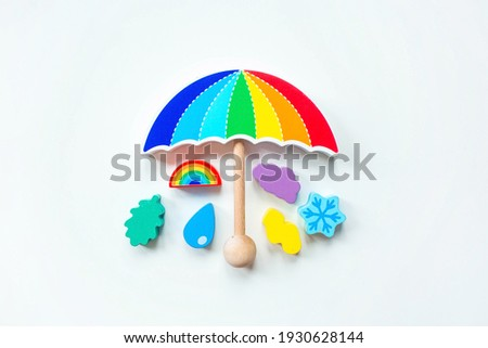 Balancer toys on a white isolated background. Children's wooden toy in the form of an umbrella. Educational logic toys for children. Montessori Games for child development. Сток-фото ©