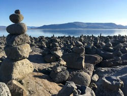 Balancing cairn of stones at the coastline of Reykjavik