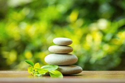 balancing pile of pebble stones, like ZEN stone, outdoor in springtime, spa wellness tranquil scene concept, soul equanimity mental calmness picture