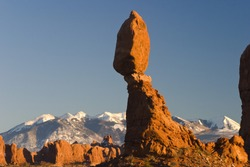 Balancing rock with Manti La Sal mountains in the background, Arches Nat. Park, Utah