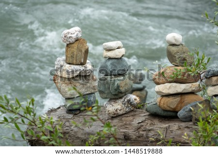 Balancing stones in equilibrium. Meditation and rest on the bank of the river.