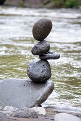 Balancing stones in the river