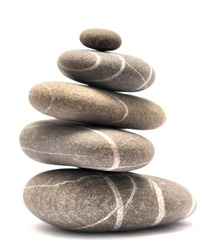 balancing stones isolated on white background (series)