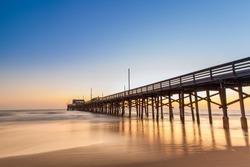 Balboa pier in Newport Beach, California at sunset, USA