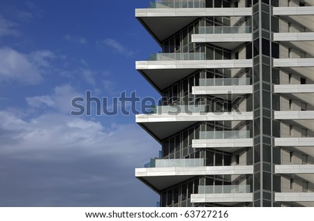 Balconies of modern hotel on the blue sky background