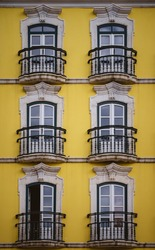 Balcony doors on yellow wall