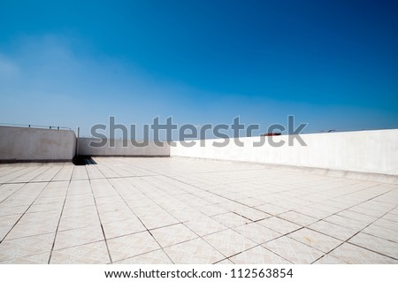 Balcony,  floor, concrete fence and blue sky. Outdoor architecture, bottom perspective