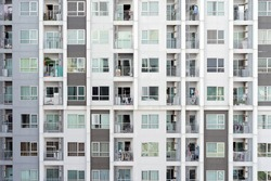 Balcony of condominium or apartment buildings windows. Glass architecture facade design in urban city, Downtown in city. Residential rooms.